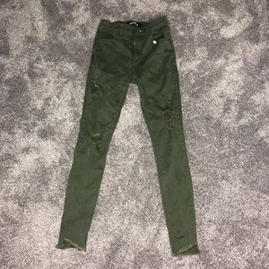 army green ripped jeans